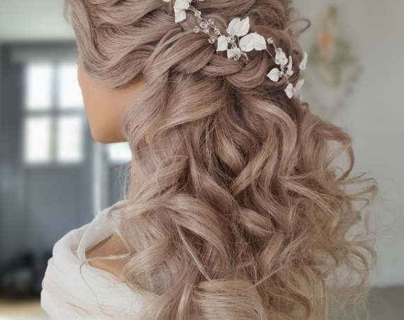 Half up down style incorporating braids