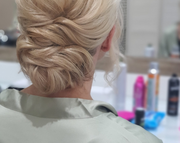 Big textured bridal hairstyle for blonde hair