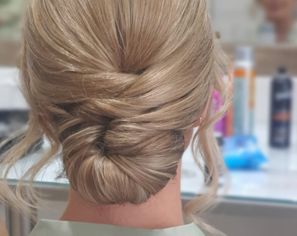 Low bun style with crossover detail for shorter hair