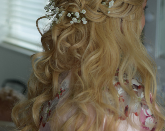 Half up/down bridal boho style with braids and flowers